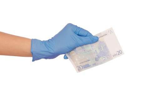 doctor putting money: doctor holding fake of 20 euro in the hand