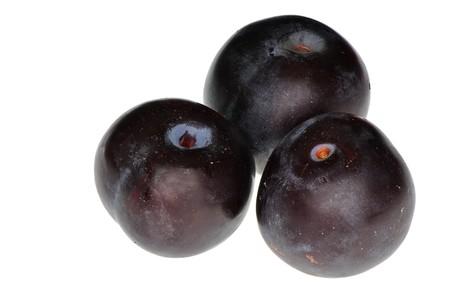 vitamines: Three tasty juicy plums for freshening juice with vitamines Stock Photo