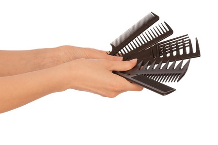hairdresser holding black tools for haircut Stock Photo - 7992097