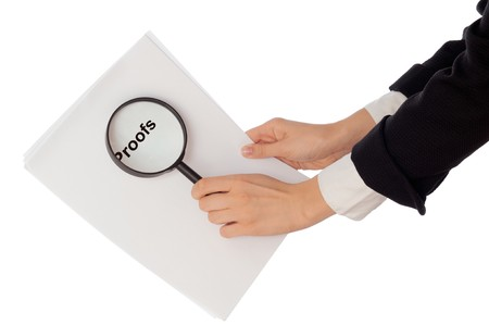 Investigator examines in details the materials of proofs reported by advocate photo