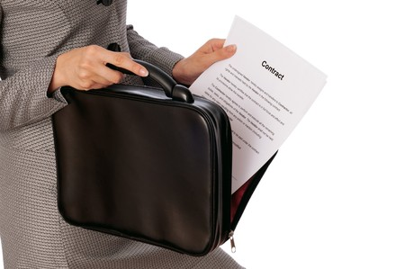 signing authority: Suitcase with blank contracts for new employees