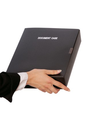 The office worker holds the document case in the hands photo
