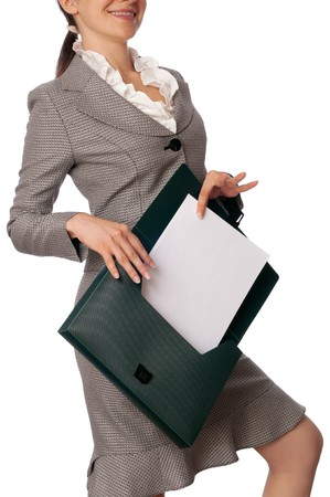 Woman holding suitcase with documents in the hands photo
