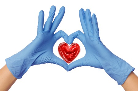 surgical glove: cardiologist in blue gloves saving life of all his patients