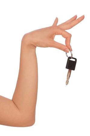Schlüssel aus dem neuen Haus in Händen der Frau  Lizenzfreie Bilder - 8135410