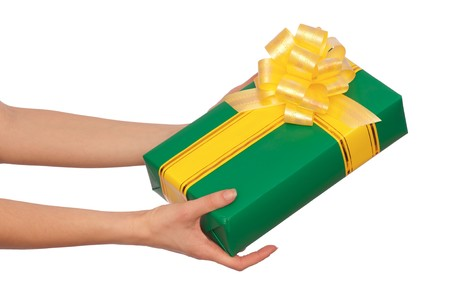 woman giving a green box with yellow ribbon as a gift photo
