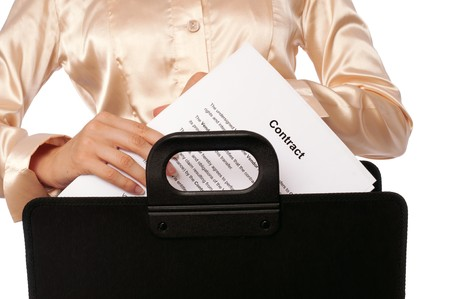 signing authority: Businesswoman taking out from a suitcase contract for new employees