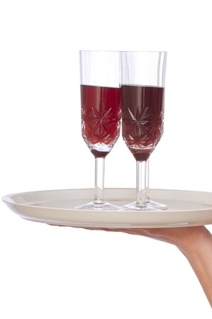 A waiter takes a glass of champagne from a tray with two glasses photo