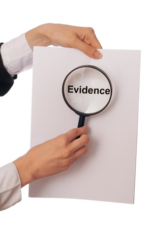 Investigator examines in details the materials of evidence reported by advocate Stock Photo