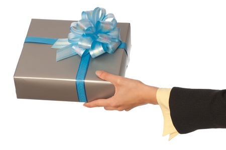 woman giving a silver box with blue bow as a gift for christmas photo