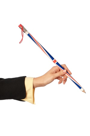 businesswoman drawing diagrams for her partners on the meeting with big funny pencil photo