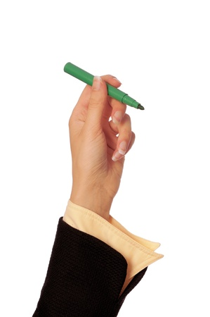 businesswoman drawing scheme with green felt-tip pen photo