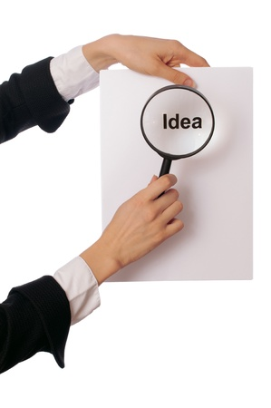 publicist: Detailed consideration of the document with good new idea for the new project Stock Photo