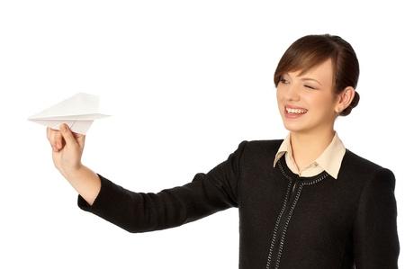 Businesswoman throwing white paper plane on the break Stock Photo - 8509670