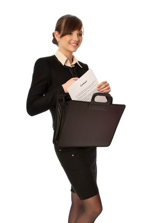 Businesswoman taking out from a suitcase contract for new employees photo