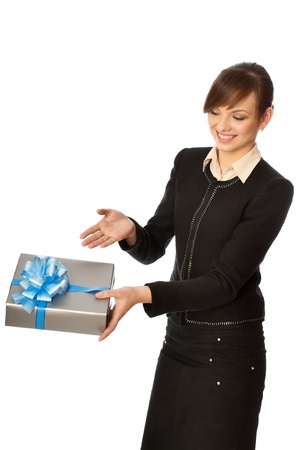 Woman giving a silver box with blue bow as a gift Stock Photo