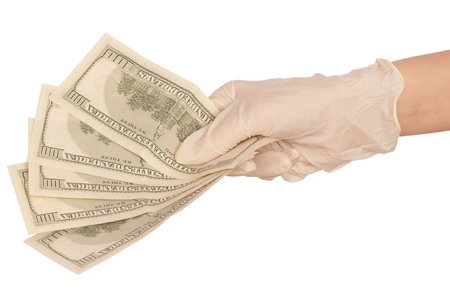 doctor putting money: doctor take of dollars in the hand
