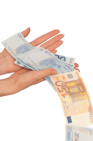 doctor putting money: Leak of money from the hands of the improvident person Stock Photo
