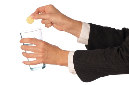 depressant: Businesswoman throws a pill from headache to the glass with water