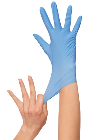 Doctor putting on blue sterilized medical glove for making operation photo