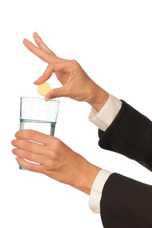 Businesswoman throws a vitamin pill to the glass with water Stock Photo - 8657776