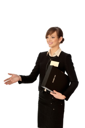 woman showing her badge at the entrance of meeting room and gives hand for a handshake photo
