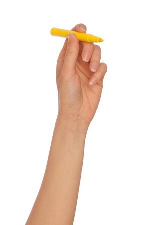 businesswoman drawing scheme with yellow felt-tip pen photo