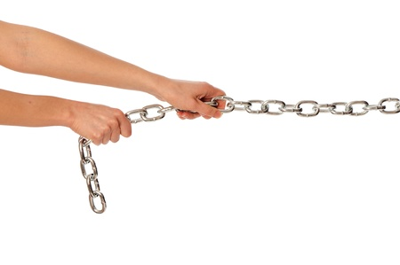 Woman pulling a long heavy metal chain Stock Photo - 8712940