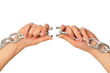 woman tearing a heavy chain by hands as a symbol of freedom Stock Photo - 8713029