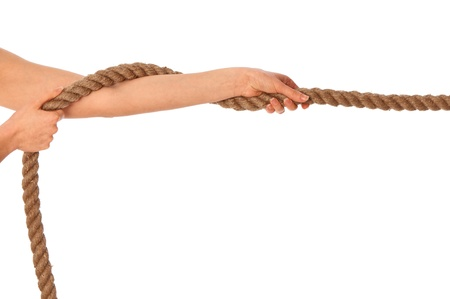 The strong-willed woman plays of pulling of a rope and wins Stock Photo - 8713017