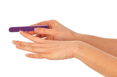 emery: woman files her nails by emery board from manicure set
