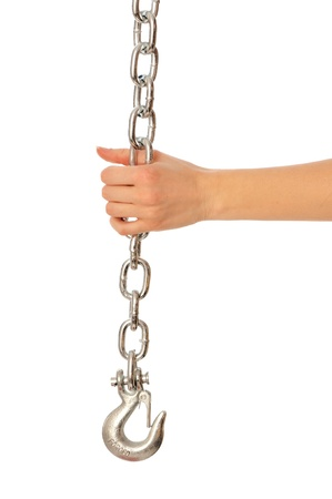 perversion: chain with a hook in the hands of crane operator at construction site