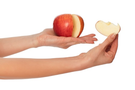 corroboration: woman holding in the hand one fresh red Apple with a slice of Apple