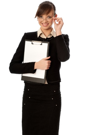 The new worker holds clipboard with the white blank paper in the hand photo