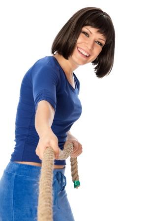 La mujer de car�cter fuerte juega de tirando de una cuerda y wins Foto de archivo - 8823927