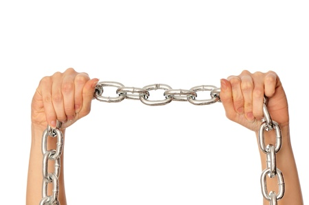 woman breaking the chain by hands for liberation as a symbol of captivity Stock Photo - 8806600
