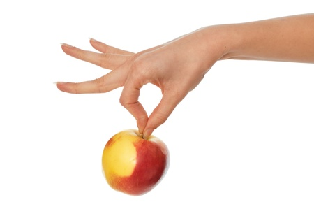 corroboration: woman holding in the hand one fresh yellow with red-edged Apple Stock Photo