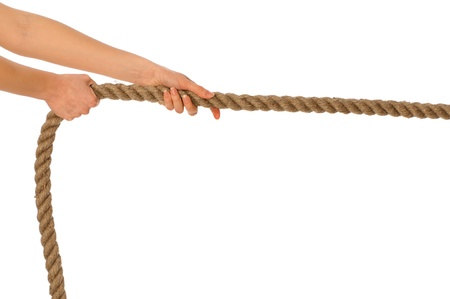 The strong-willed woman plays of pulling of a rope and wins photo