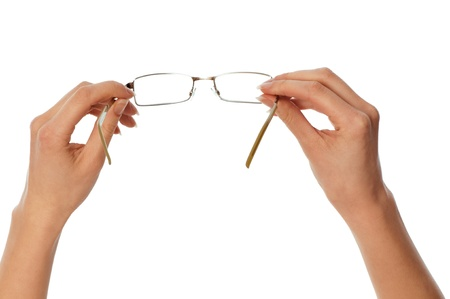 opthalmology: woman holding stylish and trendy glasses in the hand for eyes protection
