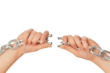 woman tearing a heavy chain by hands as a symbol of freedom Stock Photo - 8819606