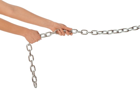 Woman pulling a long heavy metal chain photo