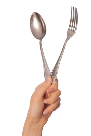 woman holding tablespoon and fork in the hand for lunch eating