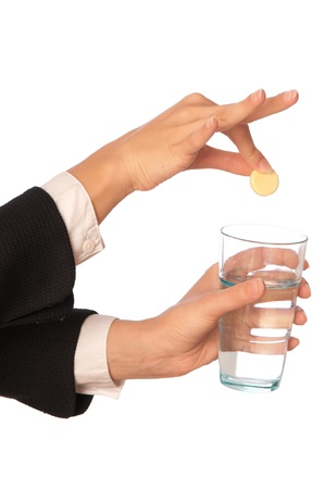 disintegrate: Businesswoman throws a pill from headache to the glass with water
