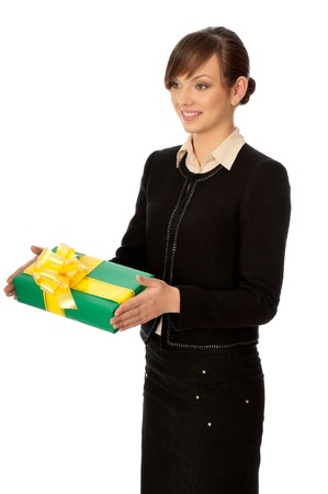 Woman holding a green box with yellow bow as a present photo