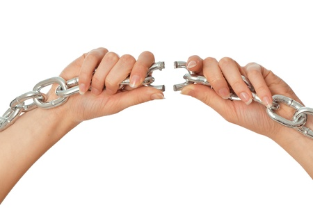 woman tearing a heavy chain by hands as a symbol of freedom