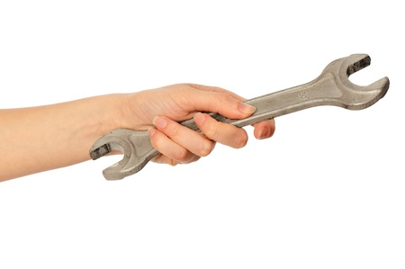 woman holding big chrome vanadium spanner in the hand photo