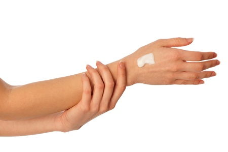 damping: woman lubricates the hands skin with cosmetic cream