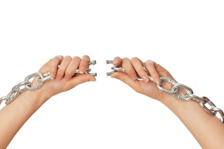 woman tearing a heavy chain by hands as a symbol of freedom photo
