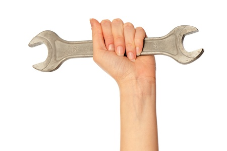 woman holding big chrome vanadium spanner in the hand Stock Photo - 8903050