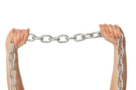 woman breaking the chain by hands for liberation as a symbol of captivity Stock Photo - 8965367